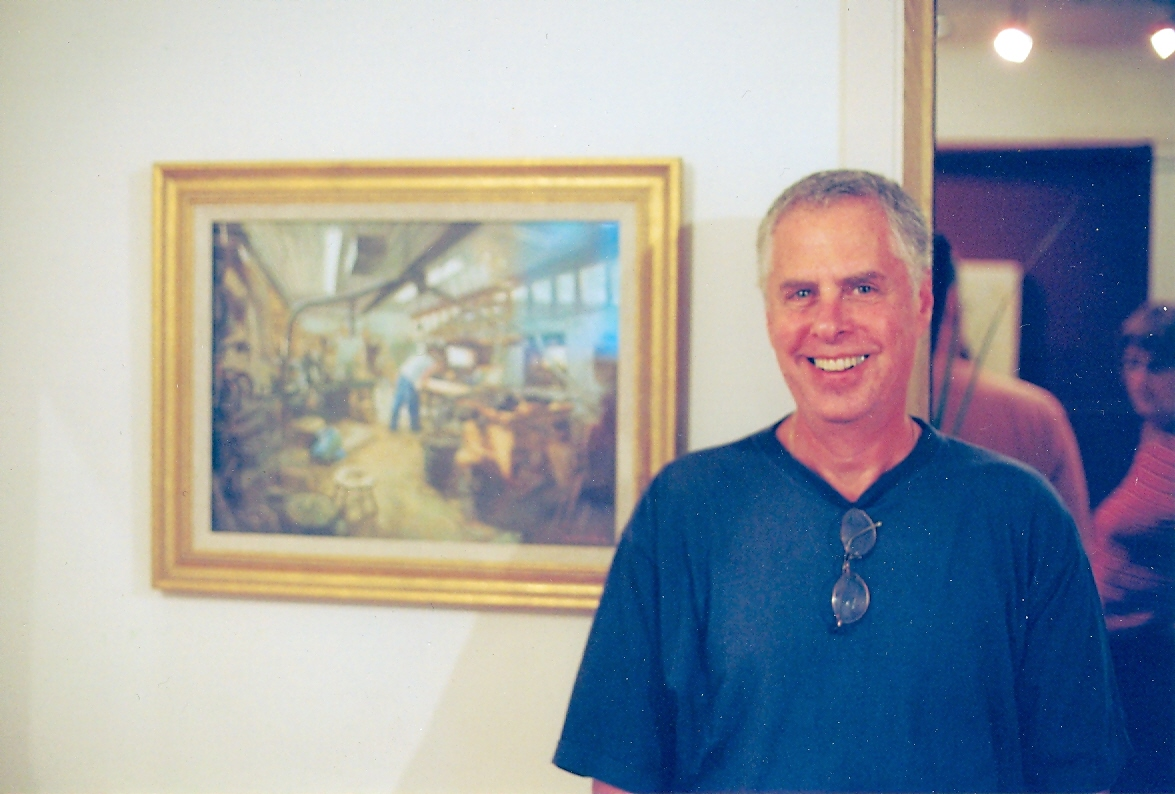 brahm friedlander beside painting of shop